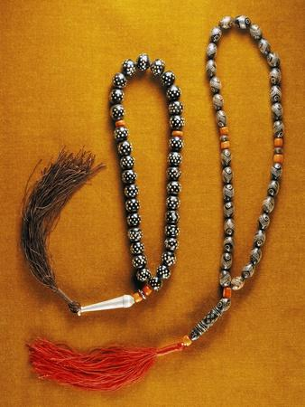 https://imgc.allpostersimages.com/img/posters/muslim-rosary-beads-inlaid-with-black-coral-and-red-coral-beads-yemen_u-L-POPDYE0.jpg?p=0