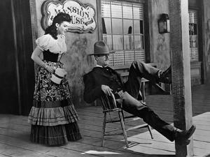 MY DARLING CLEMENTINE, 1946 directed by JOHN FORD Linda Darnell and Henry Fonda (b/w photo)