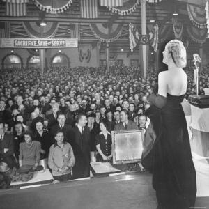 Actress Carole Lombard Performing to Help Sell War Bonds During Rally by Myron Davis