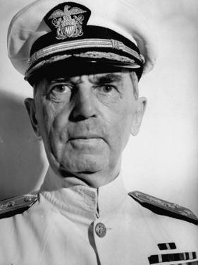 Admiral William D. Leahy, Wearing White Summer Navy Uniform and Braided Cap by Myron Davis