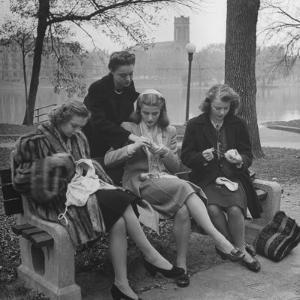Members of Ballet Russe Sitting in a Park Mending their Shoes and their Tights by Myron Davis