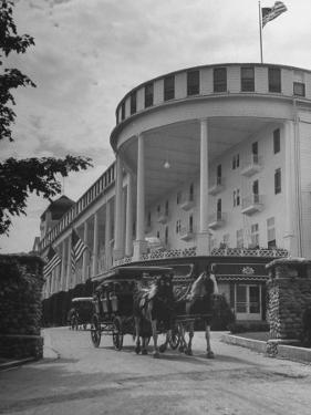 Old-Fashioned Surrey Type Carriages on Mackinac Island Outside Grand Hotel by Myron Davis