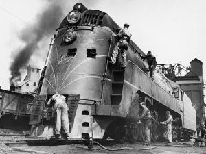 Soldiers Working on Locomotive by Myron Davis