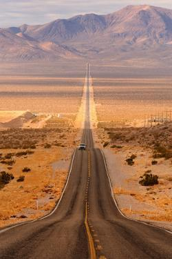 Long Desert Highway Leading into Death Valley National Park from Beatty, Nevada by Nagel Photography