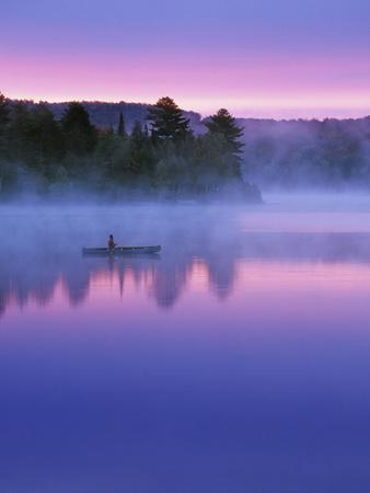 Canoeist on Lake at Sunrise, Algonquin Provincial Park, Ontario, Canada
