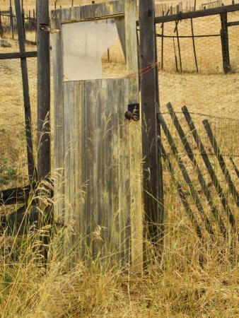 Old Door in Homestead Fence, Montana, USA by Nancy Rotenberg