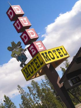 Dude Motel Sign, West Yellowstone, Montana, USA by Nancy & Steve Ross