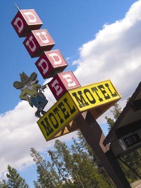 Dude Motel Sign, West Yellowstone, Montana, USA by Nancy & Steve Ross