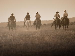 Sepia Effect of Cowboys Riding, Seneca, Oregon, USA by Nancy & Steve Ross