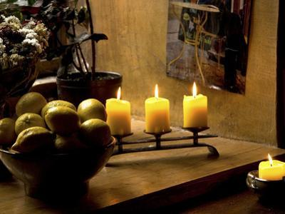 Still Life with Lighted Candles and Bowl of Lemons in Coffee Shop, Tallinn, Estonia