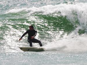 Surfer Goes Right at Tamarack Surf Beach, Carlsbad, California, USA by Nancy & Steve Ross