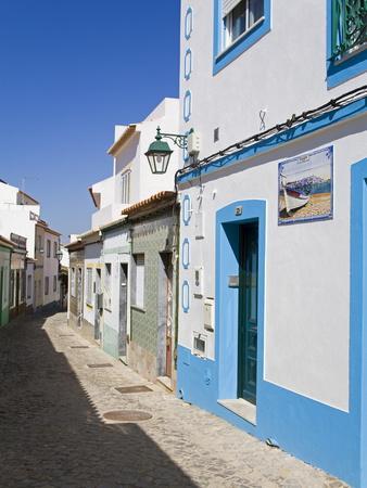 https://imgc.allpostersimages.com/img/posters/narrow-street-in-ferragudo-fishing-village-portimao-city-algarve-portugal-europe_u-L-PFNQUV0.jpg?p=0