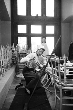 Bettina Graziani Setting Up Seats for Givenchy Runway Show (Will Model In), Paris, France, 1952 by Nat Farbman