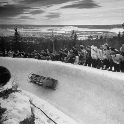 Bobsled Racing by on a Big Vendleboe Curve During the Winter Olympics