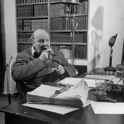 British Leader Winston Churchill Smoking a Cigar at His Desk