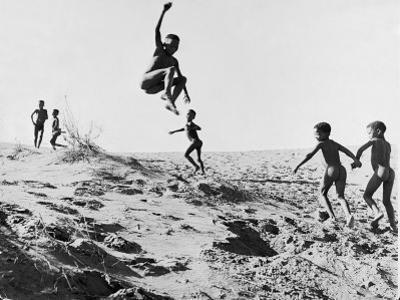 Bushman Children Playing Games on Sand Dunes