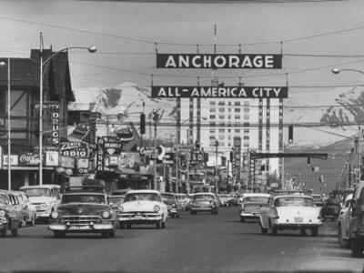 Cars Driving Through City
