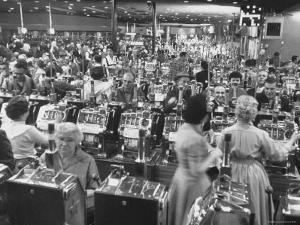 Customers at Slot Machines at Harrah's Nightclub by Nat Farbman
