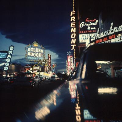 Fremont Street at Night Lit Up by Gambling Casino Neon Signs