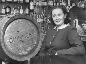 Irish Barmaid at Airport Bar with Keg of Guinness Beer by Nat Farbman