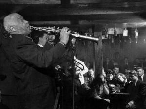 "Sidney Bechet Performing in Small Basement Club ""Vieux Colombier"" by Nat Farbman"