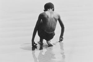 Boy Playing in the Sand at Coney Island, Untitled 30, c.1953-64 by Nat Herz