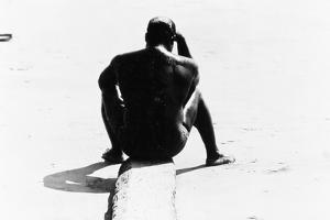 Shirtless Seated Man at Coney Island, Untitled 32, c.1953-64 by Nat Herz