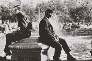 Two Men Sitting Back to Back Near Washington Square Park Fountain, Untitled 9, C.1953-64 by Nat Herz