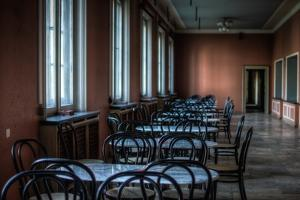 Empty Tables in Long Room by Nathan Wright