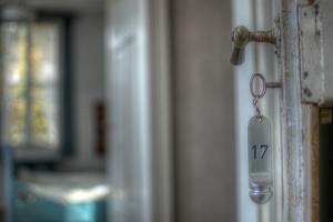 Old Door Handle with Key by Nathan Wright