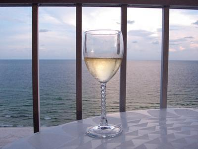 A Glass of White Wine on the Balcony of a Condo at Gulf Shores
