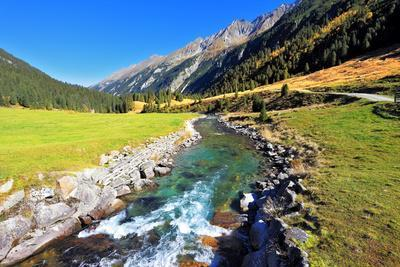 https://imgc.allpostersimages.com/img/posters/national-park-krimml-waterfalls-in-austria-headwaters-of-waterfalls-a-narrow-fast-roiling-river_u-L-Q105K620.jpg?p=0