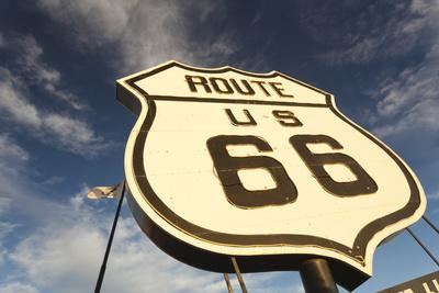 https://imgc.allpostersimages.com/img/posters/national-route-66-sign-at-sunset-elk-city-oklahoma-usa_u-L-PN6TTN0.jpg?artPerspective=n