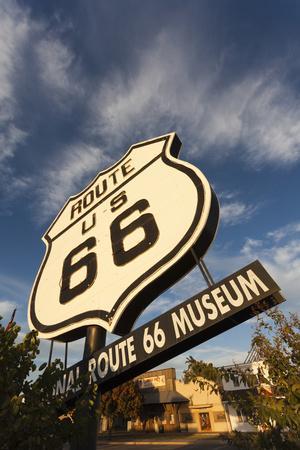https://imgc.allpostersimages.com/img/posters/national-route-66-sign-at-sunset-elk-city-oklahoma-usa_u-L-PN6VKG0.jpg?p=0