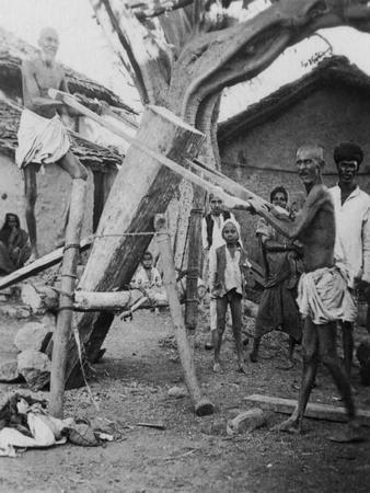 https://imgc.allpostersimages.com/img/posters/native-sawyers-india-c1927-c1931_u-L-PTY02B0.jpg?p=0