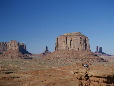 https://imgc.allpostersimages.com/img/posters/navajo-lands-arid-landscape-with-eroded-rock-formations-monument-valley-usa_u-L-P1TBFC0.jpg?p=0