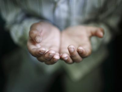 A Hand of a Muslim Boy Offering Prayer Is Pictured During the Holy Fasting Month of Ramadan