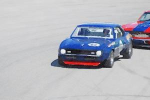 Chevy Camaro on Race Track Watercolor by NaxArt