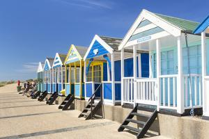 Brightly painted beach huts, Southwold Beach, North Parade, Southwold, Suffolk, England by Neale Clark