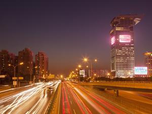 Busy Traffic and Light Trails Through City Centre, Beijing, China, Asia by Neale Clark