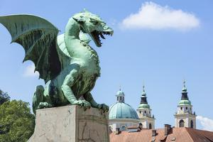 Dragon statue on the Dragon Bridge (Zmajski most) in front of the Ljubljana Cathedral, Slovenia by Neale Clark
