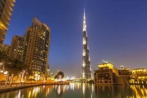 Dubai Burj Khalifa and Skyscrapers at Night, Dubai City, United Arab Emirates, Middle East by Neale Clark