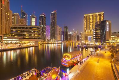 Dubai Marina Skyline and Tourist Boats at Night, Dubai City, United Arab Emirates, Middle East by Neale Clark