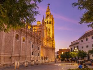 Seville Cathedral of Saint Mary of the See, and La Giralda bell tower at sunset, Seville, Spain by Neale Clark