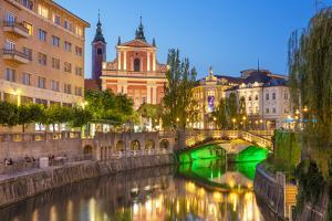 The pink Franciscan Church of the Annunciation, Ljubljanica River and the Triple Bridge, Slovenia by Neale Clark