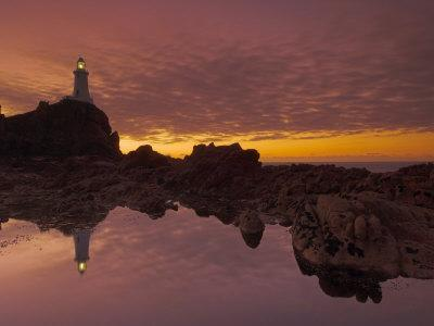 Dramatic Sunset and Low Tide, Corbiere Lighthouse, St. Ouens, Jersey, Channel Islands, UK