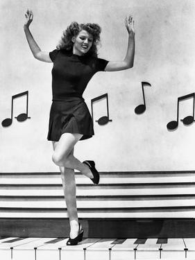 Rita Hayworth Music Notes Background in a Dancing Pose by Ned Scott