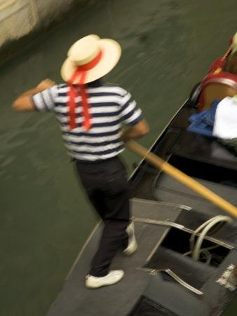 Gondolier, Venice, Italy by Neil Farrin