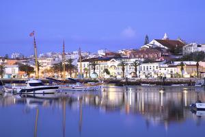 Marina and City of Lagos, Lagos, Western Algarve, Algarve, Portugal, Europe by Neil Farrin