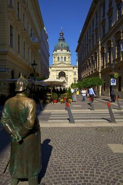 Statue of Policeman with St. Stephen's Basilica, Budapest, Hungary, Europe by Neil Farrin